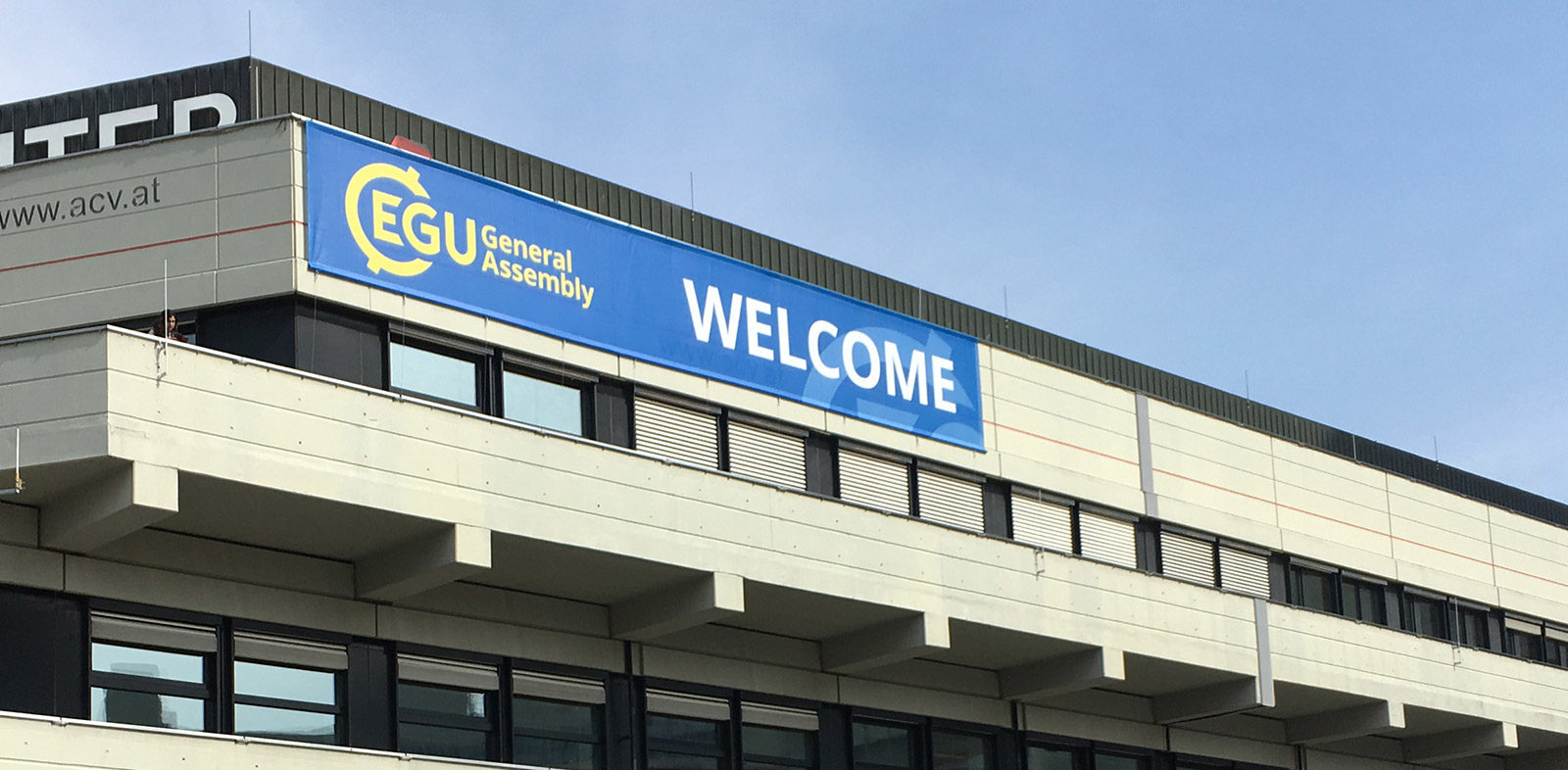 EGU welcome banner on building