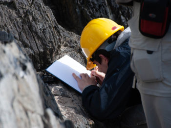 Student with notebook and hard hat