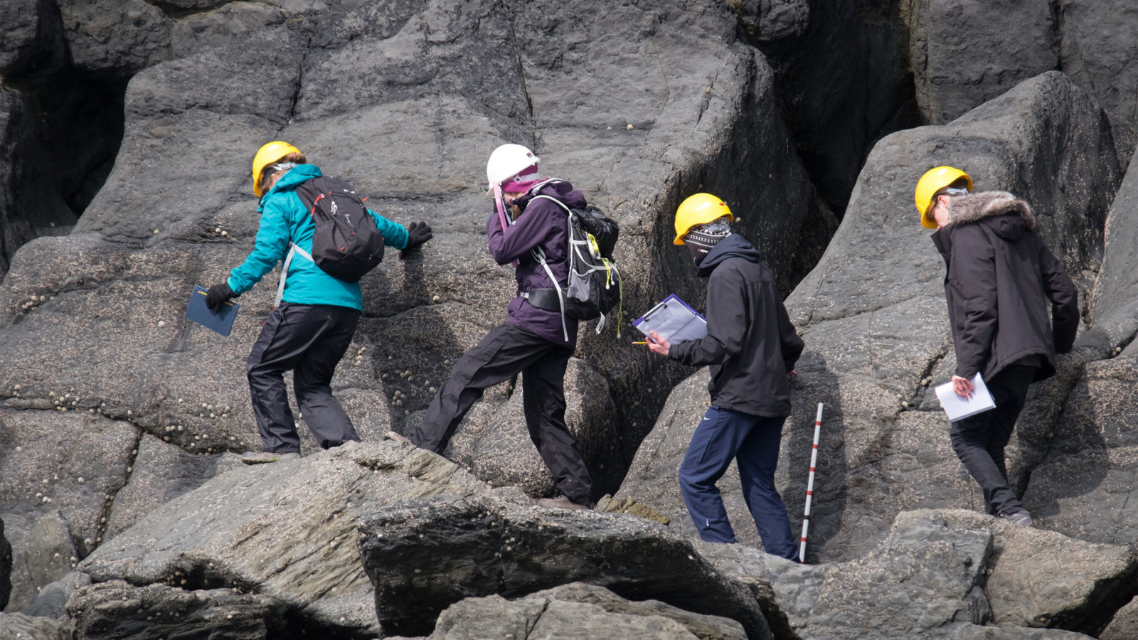 students on rock exposure