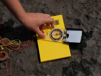 Hand on compass clinometer